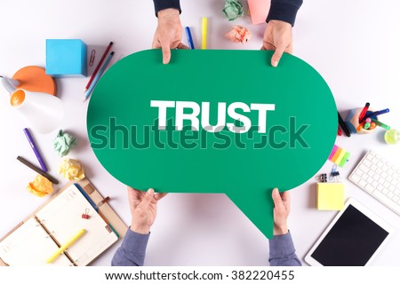 Two people holding speech bubble with TRUST concept #382220455