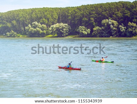 two people in kayaks on the river, water sports and recreation #1155343939