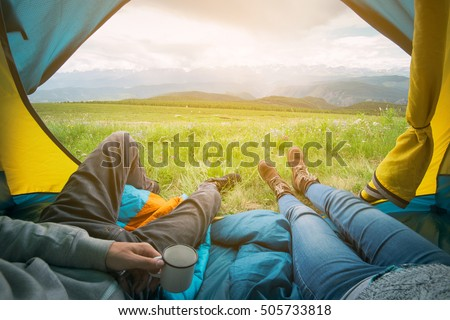 Two people lying in tent with a view of mountains. Altay, Russia. #505733818
