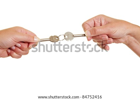 Two people pulling on keys in controversy
