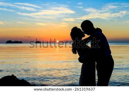 Two people silhouettes on beach  sunset  Foto stock ©