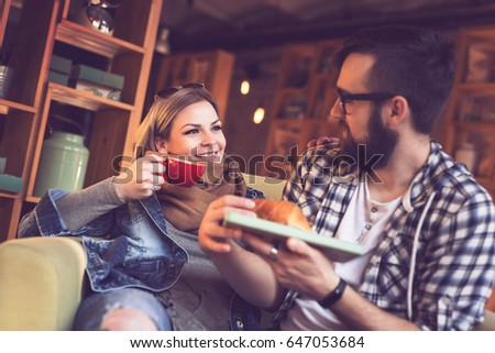 Two people sitting in a cafe, having breakfast and enjoying a time spent with each other #647053684