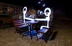 two people sitting on the bench are drawn with freeze light
