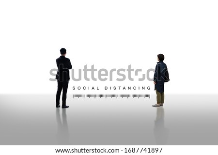 Two people standing keep distance with the word social distancing in between concept, New normal concept, People keeping distance for infection risk and disease Coronavirus.