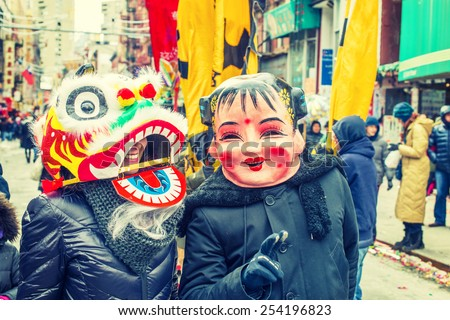 stock-photo-two-people-wearing-traditional-chinese-masks-big-head-doll-and-lion-walking-on-street-in-254196823.jpg