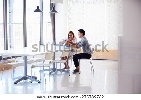 Two people working with digital tablet in empty meeting room #275789762
