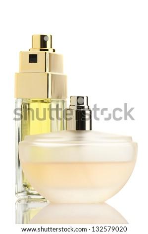 Two perfume bottles isolated on white background. - stock photo