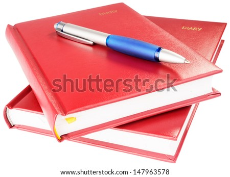 Two personal organizers and ball-point pen isolated on the white