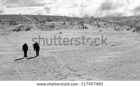 Two Persons Walking Through the Winter Landscape in Jeseniky Mountains, Czech Republic