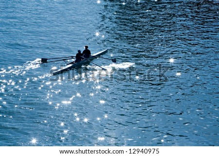 Two persons with oars in a kayak in the sea in a sunny day