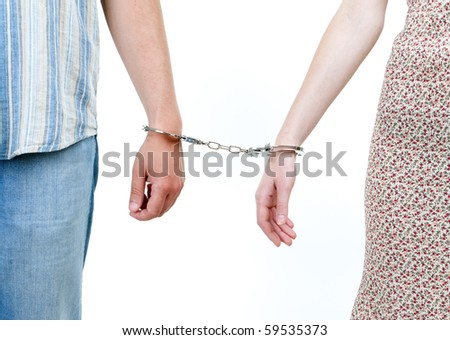 two persons, woman and man  joint with handcuffs