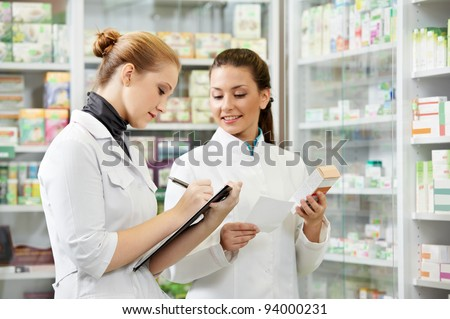 two pharmacist chemist women working in pharmacy drugstore
