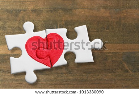 Two pieces of a puzzle with heart #1013380090