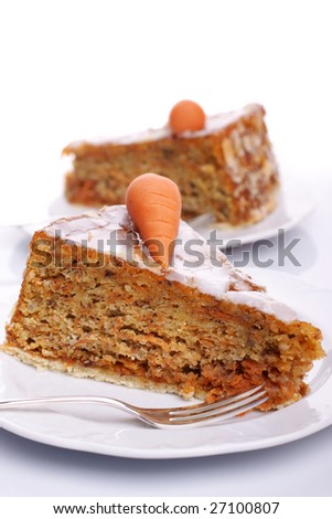 Two pieces of carrot cake on white plates over bright background