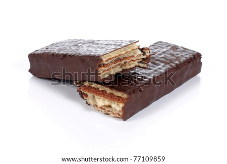 two pieces of chocolate bar on white table
