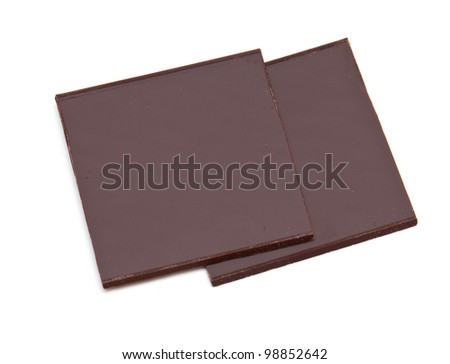 two pieces of chocolate isolated on white