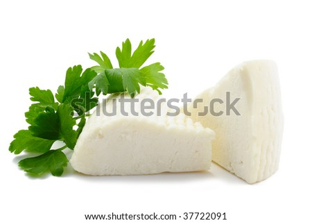 Two pieces of soft cheese isolated on white background