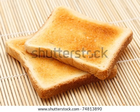 Two pieces of toast on the table - stock photo