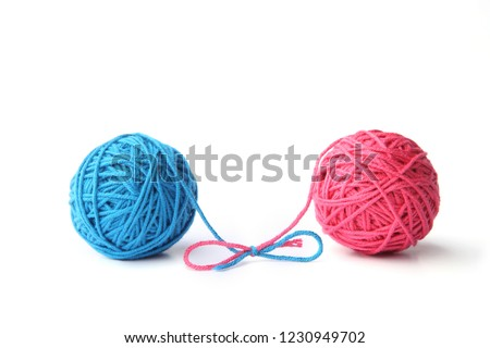 Two pink and blue cotton thread balls tied in bow isolated on white background.  Different color pink and blue thread balls.   Stock foto ©