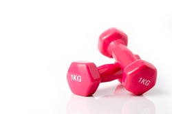 Two pink dumbbells isolated on white background