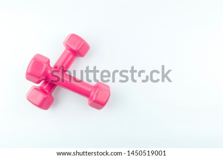 Two pink dumbbells isolated on white background.