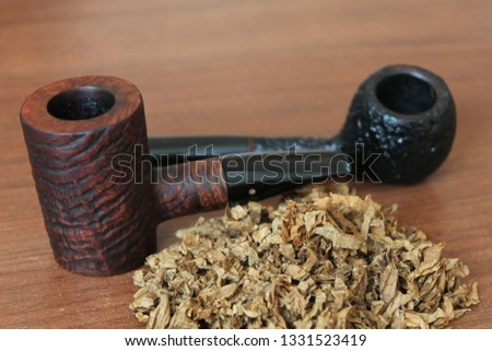 Two pipes with tobacco #1331523419