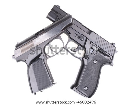 Stock photo of two pistols. Woman arrested in Larangeiras bandishing two pistols in bar. Officers of the BOPE (Battalion Special Operations Police) were drinking in bar when the young woman pulled out her guns
