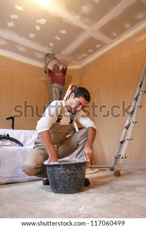 Two plasterers working on the same project