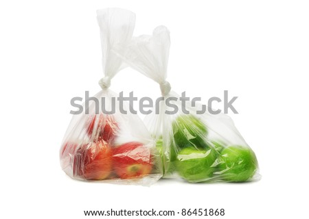Two plastic bags of red and green apples on white background