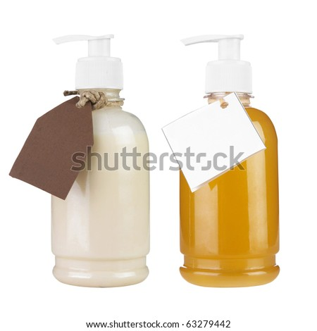 Two plastic bottles of body care and beauty products with label isolated on white background