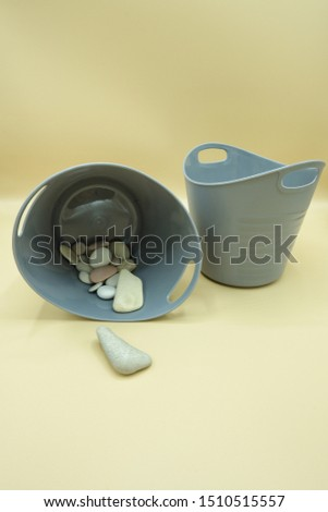 two plastic containers and some stones