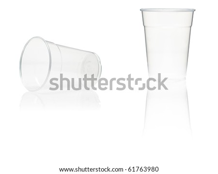 Two plastic cups with reflection on white background - stock photo