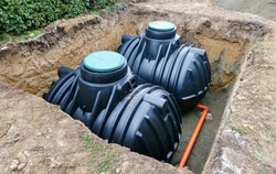 Two plastic underground storage tanks placed below ground for harvesting rainwater. The underground water septic tanks, for use as ecological recycling rainwater.