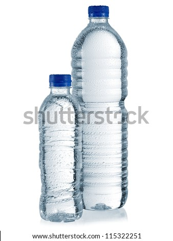 Two plastic water bottles with drops - stock photo