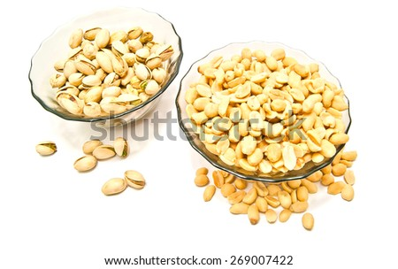 two plate with different nuts on white background