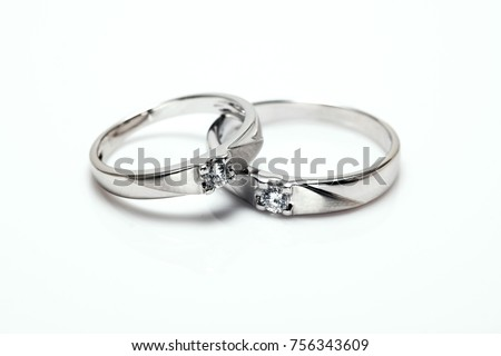 Two Platinum wedding rings with diamond hook together , Isolate on white with Path #756343609
