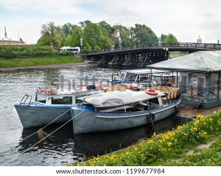 Two pleasure boats at the pier in the Kronverksky Strait near the Peter and Paul Fortress in St. Petersburg in the summer #1199677984