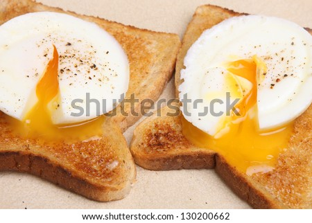 Two poached eggs on buttered toast. - stock photo