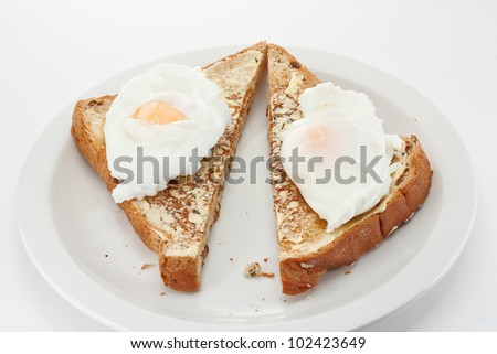 Two poached eggs on toast triangles
