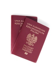 Two Polish passports on a white background.
