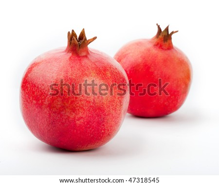 two pomegranates on a white background