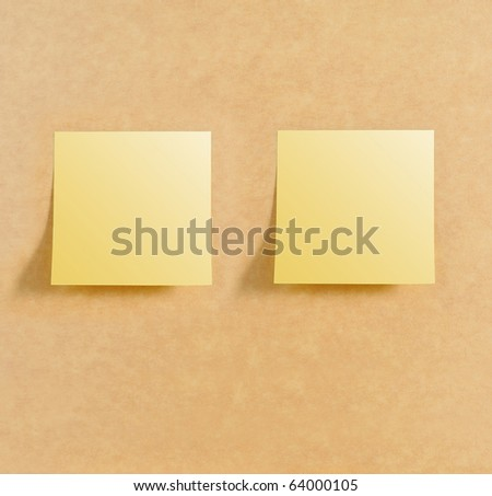 Two post it on brown board texture