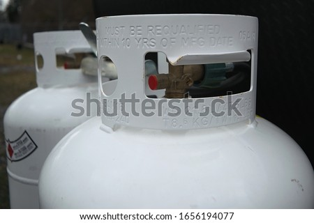 Two 20 pound propane tanks secured to the front of an RV travel Trailer ストックフォト ©