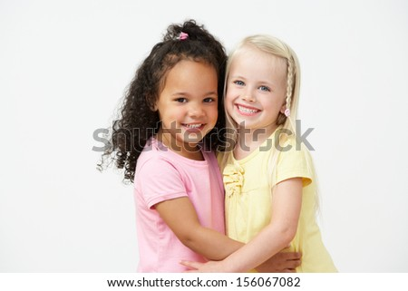 Two Pre School Girls Hugging One Another