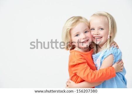 Two Pre School Girls Hugging One Another Stock photo ©