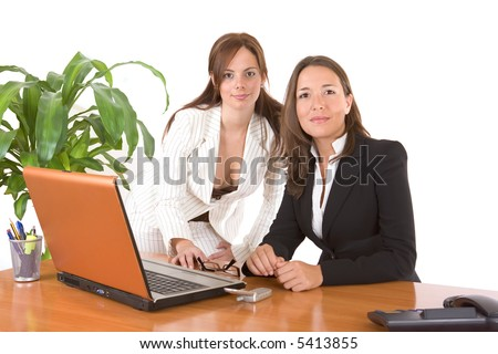 Two pretty business women working together in the office