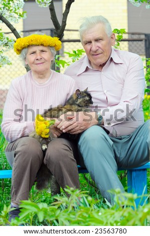 two pretty elderly peoples with cat on the hand