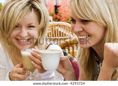 Two Pretty Girls Are Having A Coffee-Break - stock photo