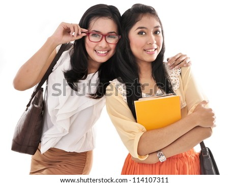 Two pretty girls best friend carrying books and bags, isolated on white background