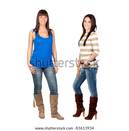 Two pretty girls with jeans isolated on a over white background